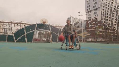 Man in Wheelchair Dribbling