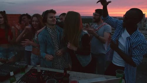 DJ Mixing Music for Friends on Rooftop