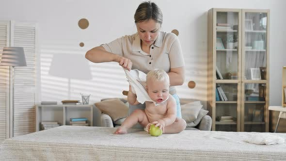 Thumbnail for Mother Changing Child