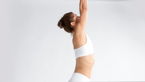 Thumbnail for Senior Woman in White Space Practice Yoga
