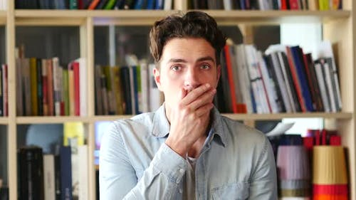 Wondering, Shocked Young Man in Office, Problem and Tragedy