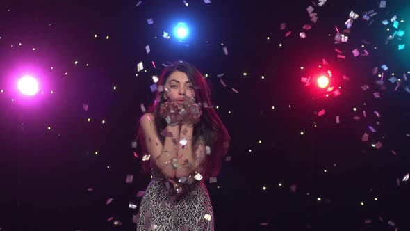 Thumbnail for Young Woman Blowing with Hands Glitter Confetti. Slow Motion