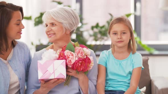 Thumbnail for Portrait of Female Family with Flowers and Gift 68