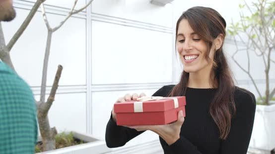 Thumbnail for Woman receiving present from a man