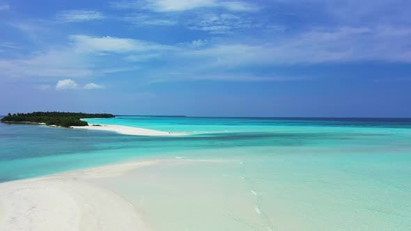 Wide overhead tourism shot of a sunshine white sandy paradise beach and blue ocean background in vib
