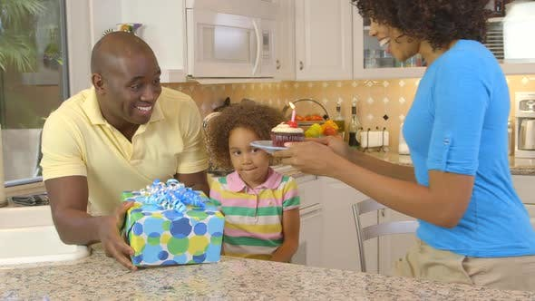 Thumbnail for African American family  having birthday celebration