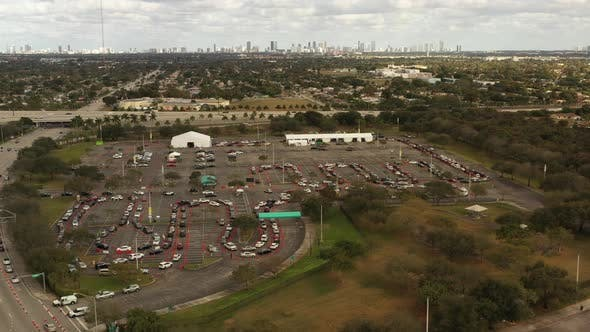People Waiting In Line Of Cars For Covid 19 Coronavirus Vaccine Shots In Miami Florida Usa