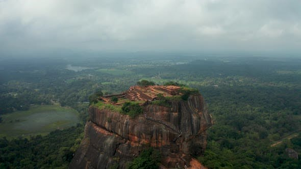 Cover Image for Aerial View of the Holy Mountain Sigiriya. Circling Around the Mountain Through the Clouds. Mountain