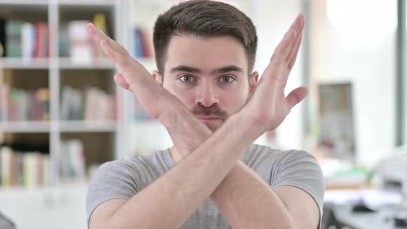 Thumbnail for Portrait of Young Man Rejecting with Arm Gesture