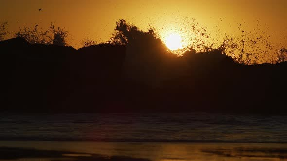 Thumbnail for Evening view of waves crashing into rocks