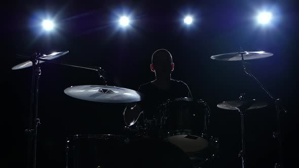 Thumbnail for Drummer Plays the Melody on the Drums Energetically. Black Background, Back Light, Silhouette, Slow