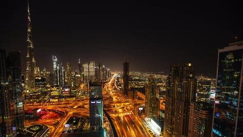 Night Timelapse of Tall Skyscrapers and Busy Highway Traffic in Dubai UAE