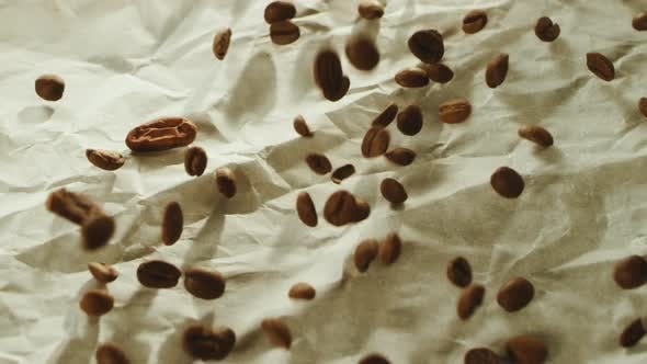 Thumbnail for Roasted Coffee Beans Falling on Wooden Table Surface in Slow Motion.