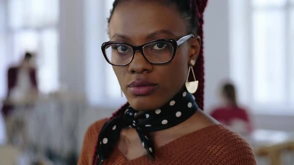 Close-up Portrait of Young Beautiful Serious Black Business Woman in Eyeglasses Looking at Camera at
