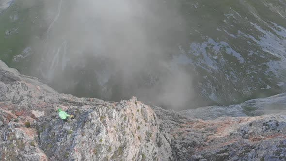 Thumbnail for Aerial Shot of Extreme Jump with Rope From the Top of the Mountain. Rope Jumping in the Mountains