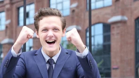 Thumbnail for Successful Excited Businessman Celebrating Success, Standing Outdoor