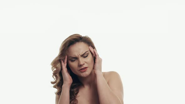 Portrait of Headache Woman on White Background