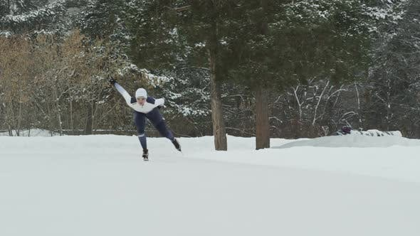 Thumbnail for Speed Skaters Sprinting in Outdoor Ice Rink