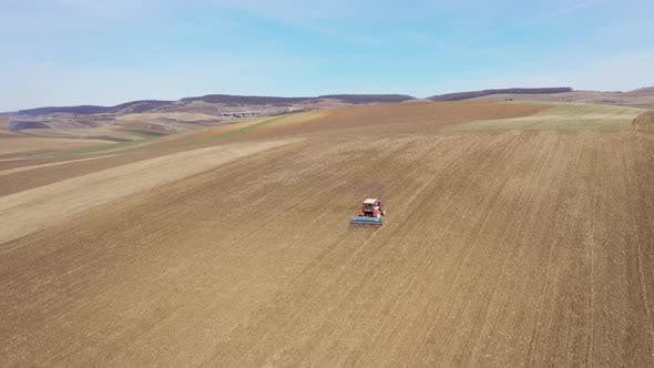 Thumbnail for Tractor Plowing the Field in the Spring