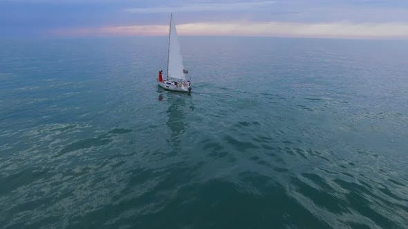 Cover Image for White Sailing Boat with Couple at Bow Swimming Down Sea Towards Horizon, Future