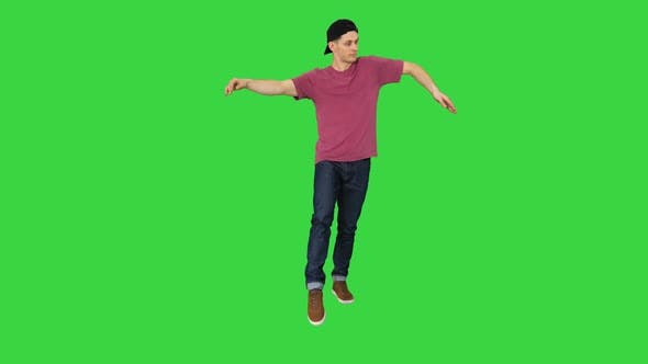 Thumbnail for The Dancer Does Wave His Arms on a Green Screen, Chroma Key.