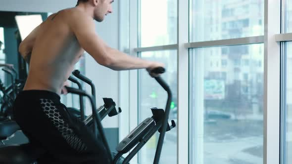 Thumbnail for Young Man Wearing Training Hardly on Cycling Machine