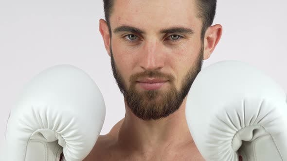 Thumbnail for Bearded Male Boxer Smiling To the Camera, Standing in Fighting Stance 1080p
