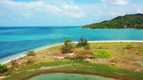 Wide flying island view of a paradise sunny white sand beach and blue sea background in high resolut