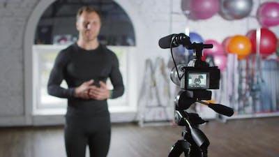 Sportsman Recording Vlog in Gym