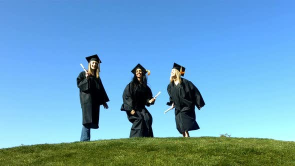 Thumbnail for Three graduates jumping and celebrating