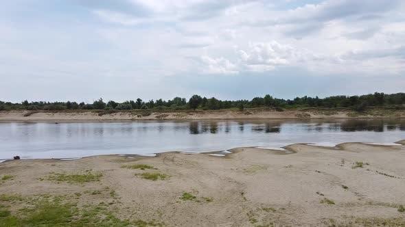 A beautiful river with a sandy coast