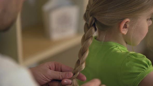 Thumbnail for Father Braiding Daughter's Hair Carefully Taking Care of Beloved Kid Family
