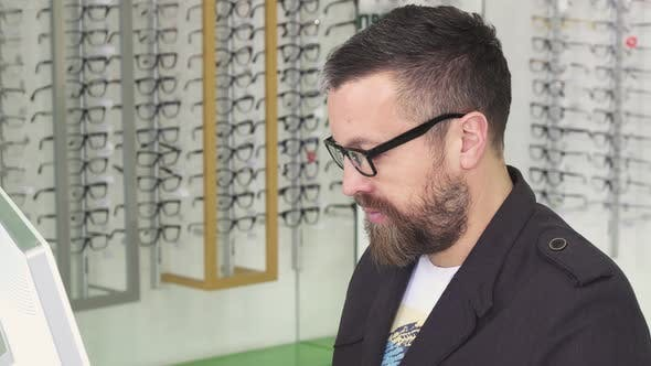 Cover Image for Professional Optometrist Working on a Computer at His Shop