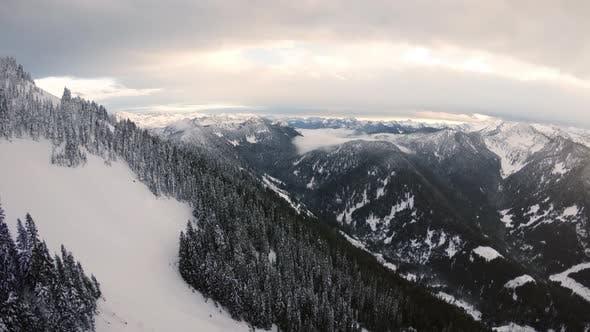 Thumbnail for Stunning Cascade Mountain Range Winter Aerial In Epic Lighting