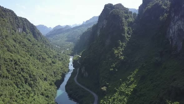 Thumbnail for Aerial View Thick Tropical Forests Cover River Canyon Banks