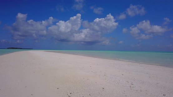 Thumbnail for Tropical overhead tourism shot of a white paradise beach and blue ocean background in colourful 4K