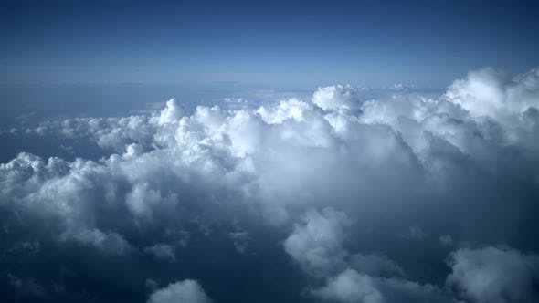 Thumbnail for Above Clouds From Airplane at Night