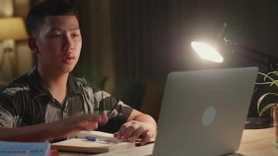 Teenage Boy Learning Online From Laptop, Raising Hand Distance Learning Online