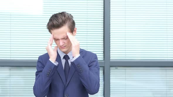 Thumbnail for Headache, Upset Gesture by Young Businessman