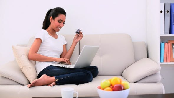 Thumbnail for Attractive Woman Sitting On Couch Using Her Laptop 2