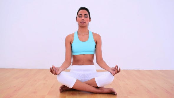 Thumbnail for Calm Woman Meditating In Lotus Position