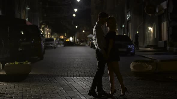 Cover Image for Two Loving People Kissing Tenderly in Night Street, Love in Big City, Dating