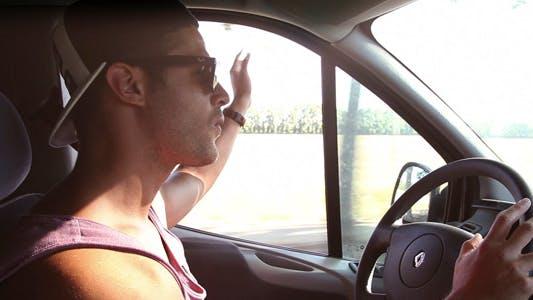 Thumbnail for Man Driving And Dancing