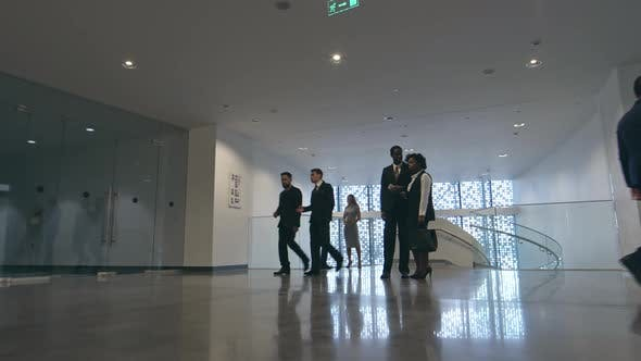 Thumbnail for Businesspeople in Lobby of Modern Business center