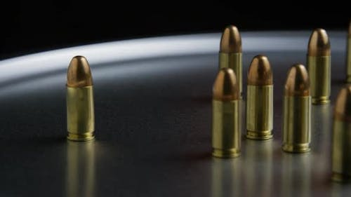 Cinematic rotating shot of bullets on a metallic surface - BULLETS 053
