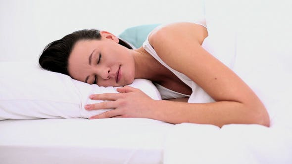 Peaceful Attractive Woman Sleeping Lying In Bed