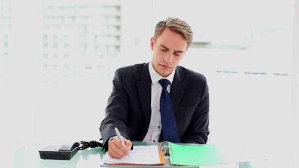 Thumbnail for Young Businessman Working At His Desk 1