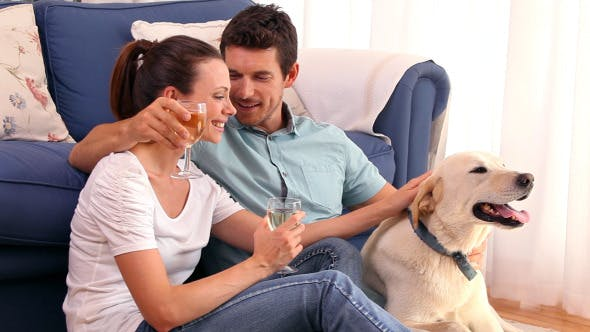Thumbnail for Happy Couple Sitting Floor Drinking Wine