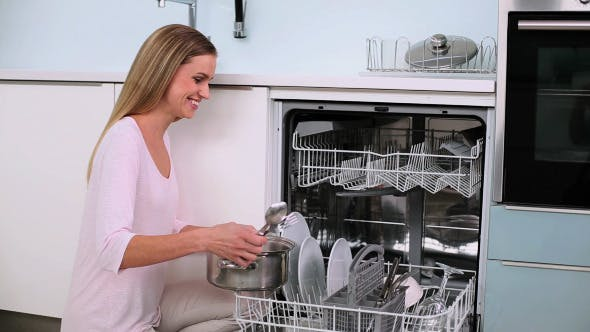 Thumbnail for Beautiful Calm Woman Filling The Dish Washer