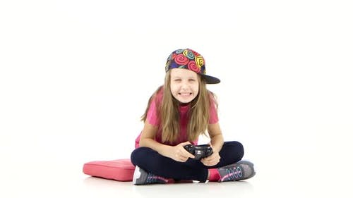 Girl with Games Console Playing Video Game and Loses, Studio